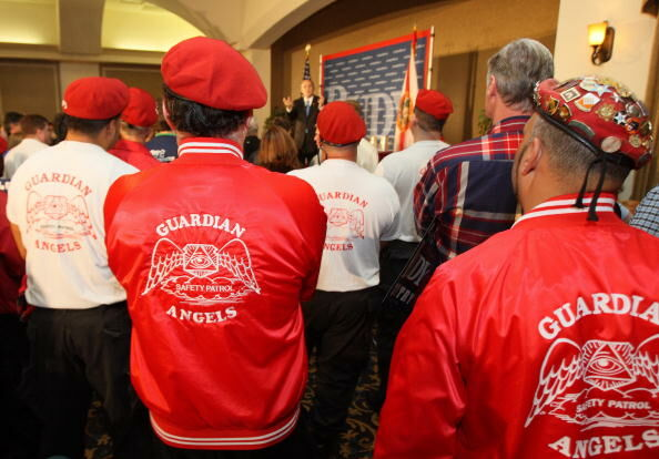 Members of the Guardian Angels, includin