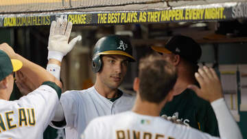 Sports Desk - A's Hold Off Houston