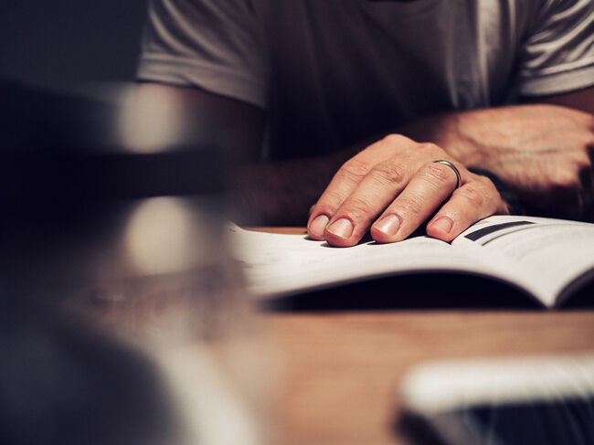 Man reading manual book