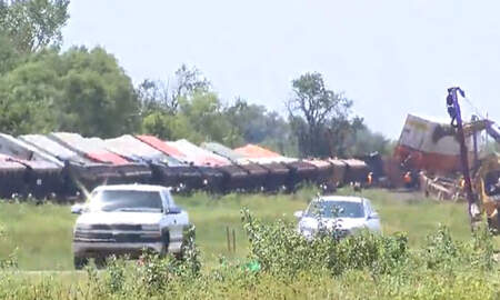 National News - High Winds Cause Over One Hundred Train Cars To Derail In Kansas