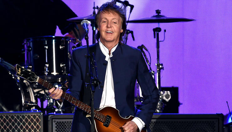 Paul McCartney Spotted Placing Coins On LIRR To Make Guitar Picks | iHeartRadio