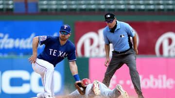 Sports Desk - Rangers split doubleheader