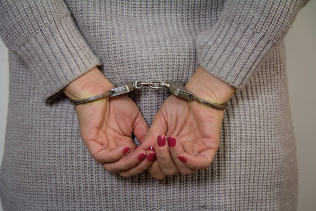 Women criminal in handcuffs arrested for crimes