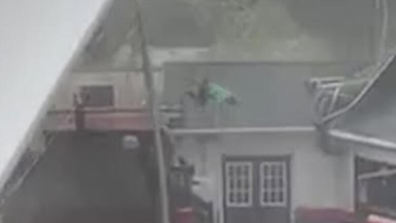 High Winds Send Worker Flying Onto Roof As He Tries To Secure Large Tent
