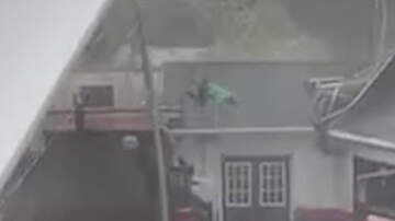 Weird News - High Winds Send Worker Flying Onto Roof As He Tries To Secure Large Tent