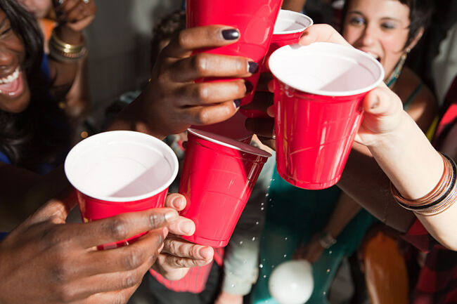 Young people with plastic cups at party  (Getty Images)