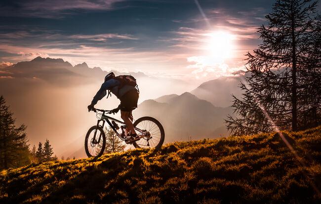 A mountain biker bikini at sunset
