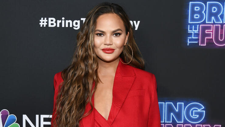 Chrissy Teigen Claps Back At User Who Tells Her To Wear A Bra | iHeartRadio