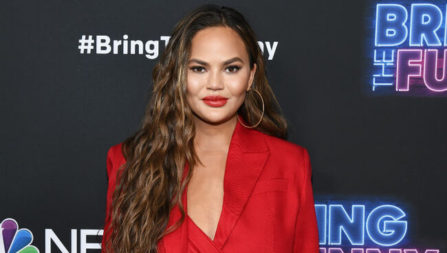 Chrissy Teigen Claps Back At Troll Who Tells Her To Wear A Bra