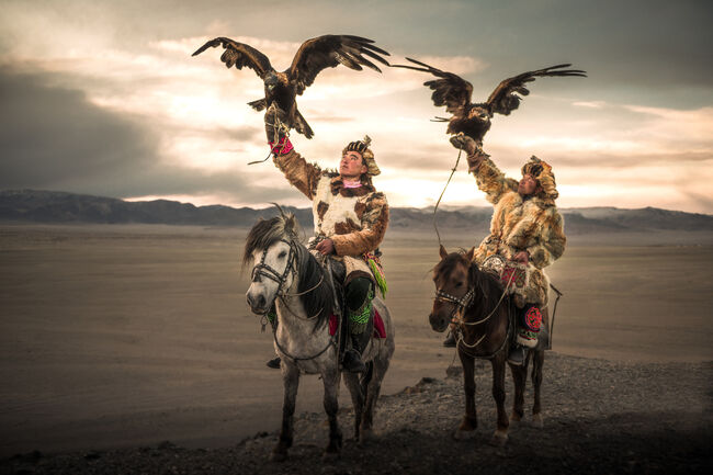 Eagle-hunters on the horse in Mongolia