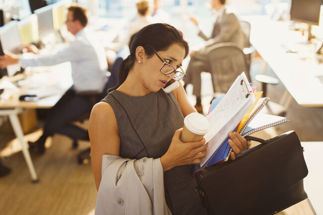 Stressed businesswoman struggling to multitask in office