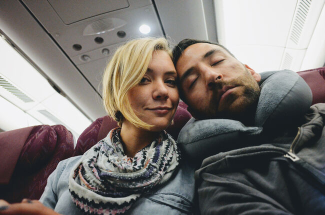 Couple Traveling In Airplane