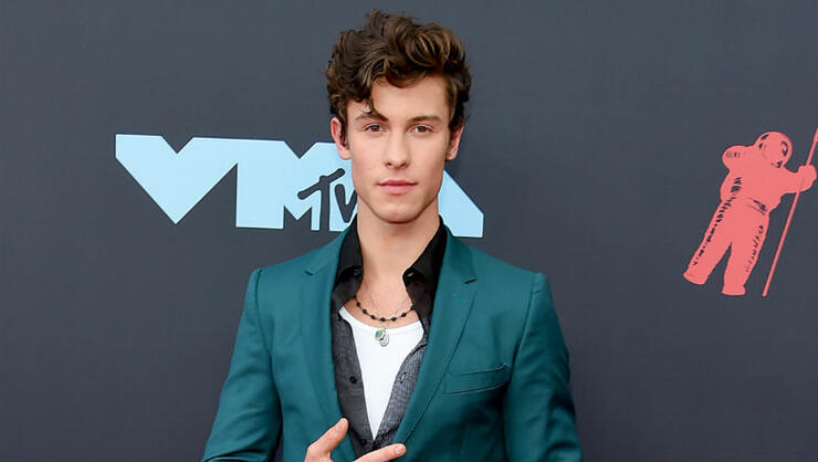 Shawn Mendes Receives 'Super Weird' Miniature Doll Of Himself | iHeartRadio