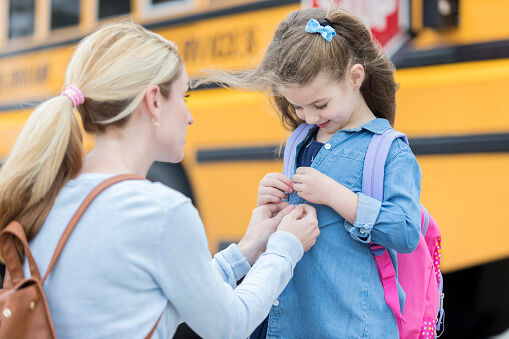 Loving mom prepares daughter for first day of school