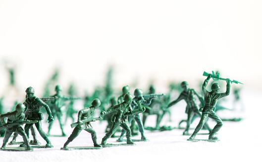 Toymaker Working On Plastic Army Women
