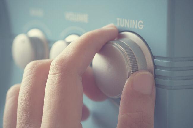 Hand tuning fm radio button.