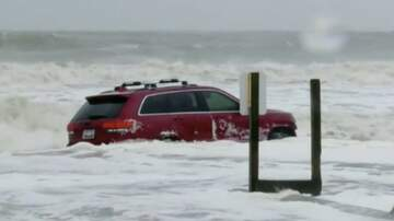 Storm Watch - WATCH: Jeep Gets Stuck in Ocean During Hurricane Dorian