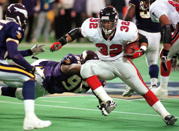 Jamal Anderson (34) of the Atlanta Falcons runs th