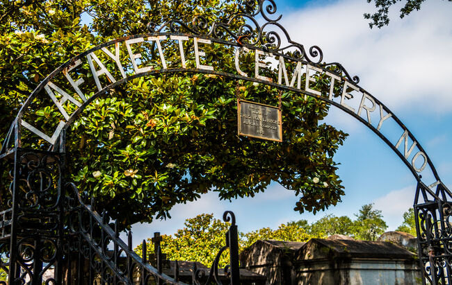 The Cast Iron Gate and Sign of Lafayette Cemetery in New Orleans