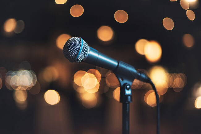 Microphone on stage against a background concert or show