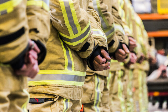Firefighter equipment fire resistant trousers and helmet emergency services
