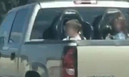 Weird News - Driver Cruises Down Highway With Kids In Booster Seats In The Cargo Bed
