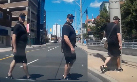 Entertainment News - Instant Karma As Jaywalker Stares Down Driver And Walks Right Into Pole