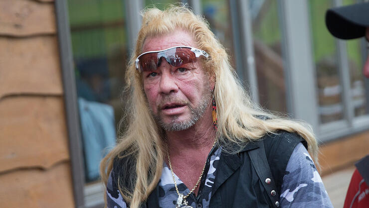Dog The Bounty Hunter Remains 'Under Doctor's Care' After Heart Emergency | iHeartRadio