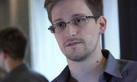 National News - U.S. Justice Department Sues Edward Snowden Over His New Memoir