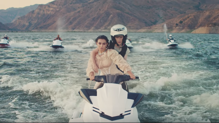 Charli XCX And Troye Sivan Do Jet Ski Tricks In '2099' Video: Watch   iHeartRadio