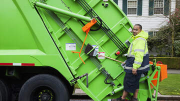 Bob Alexander -  Boy Greets Trash Collector With Bottled Water
