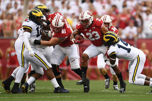 Jonathan Taylor leads Wisconsin past Michigan on Saturday