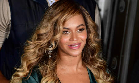 Entertainment News - Beyonce Shines In Red At Jay-Z's Mom's Birthday Party