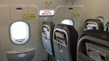 EJ - Plane Passenger Opens Emergency Exit To Get 'A Breath of Fresh Air'