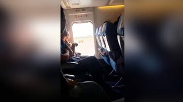 Weird News - Airline Passenger Opens Emergency Door Because The Cabin Was 'Too Stuffy'