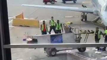 Weird News - Wild Video Captures Catering Cart Spiraling Out Of Control On Tarmac