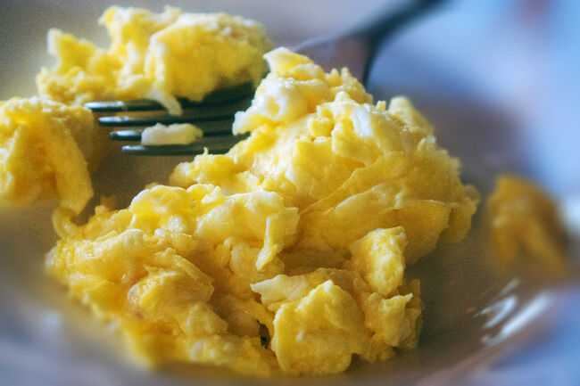 Close-up of a plate of fluffy scrambled eggs
