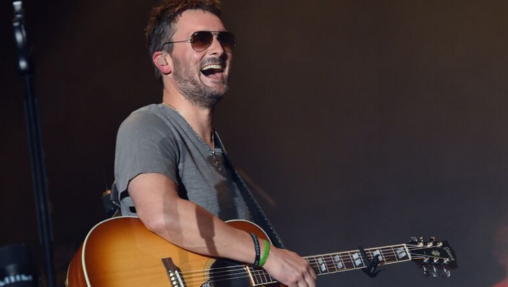 Eric Church Sees Little Girl's Sign, Donates $10,000 To Her School