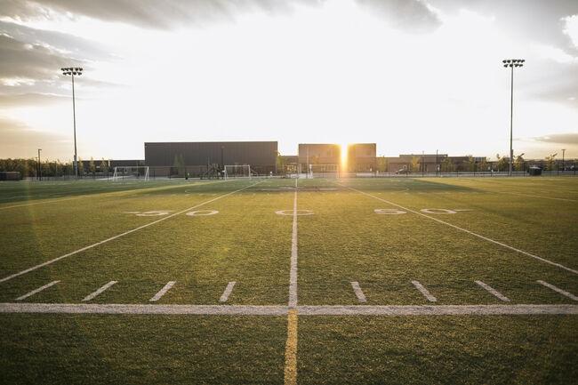 Sunny football field at sunset