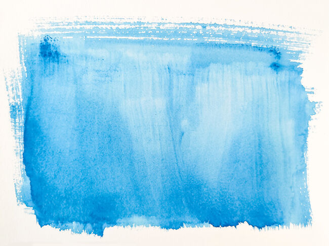 Abstract Image Of Blue Paint On White Paper