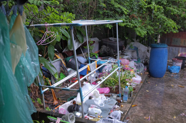 Clothes Rack And Abandoned Objects In Back Yard