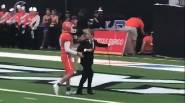 Hitman - Football Player Refuses to Leave the Field While Band was Playing