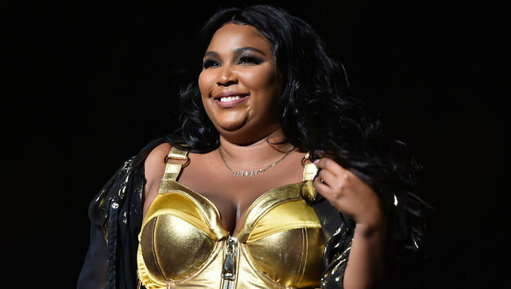 Here's EXACTLY What Lizzo Listens To To Feel Like '100% That B*tch' | iHeartRadio