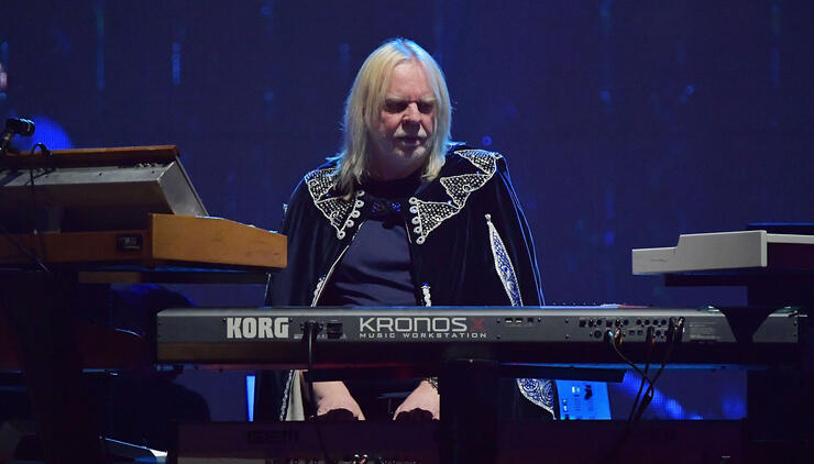 Rick Wakeman Says YES Died With Chris Squire, Opposes Own Use Of YES Name | iHeartRadio