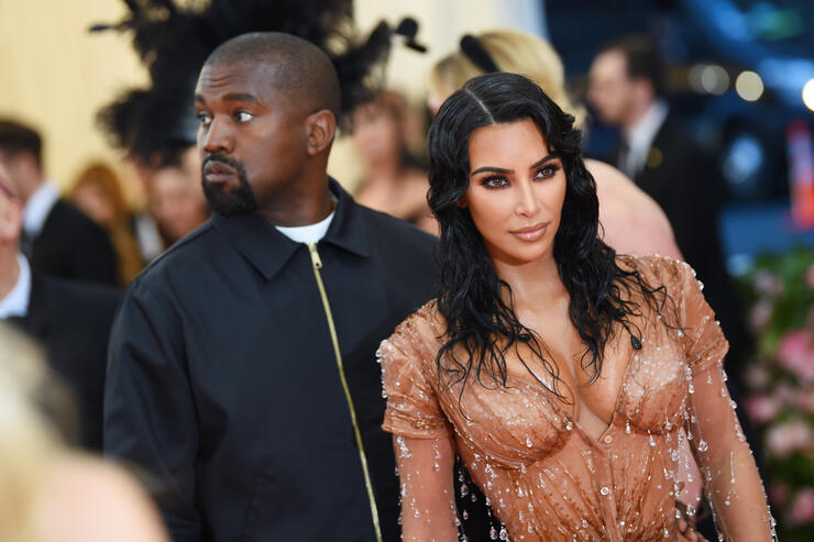 Kim Kardashian & Kanye West Almost Missed Psalm's Birth For The Met Gala | iHeartRadio