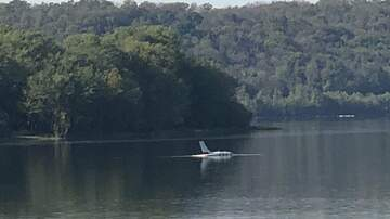 Glenn & Amy - A plane that's been floating in the river will be removed this afternoon.