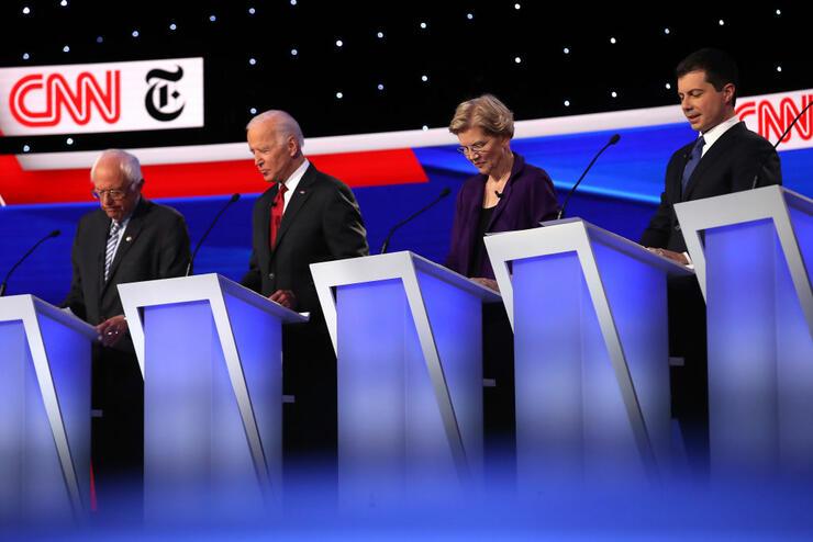 CNN Criticized for Debate Question About Ellen DeGeneres | iHeartRadio