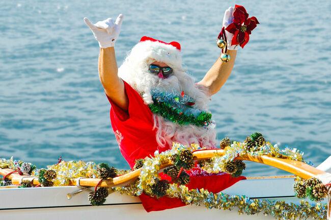 Santa Claus in Canoe Flashing Shaka