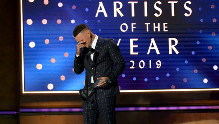 Kane Brown Tearfully Dedicates CMT Artists Of The Year Win To Late Drummer | iHeartRadio