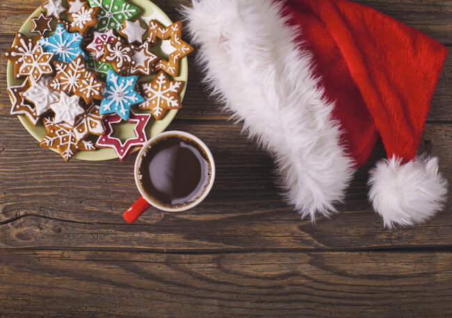 Christmas cappuccino and gingerbread cookies on rustic wooden table